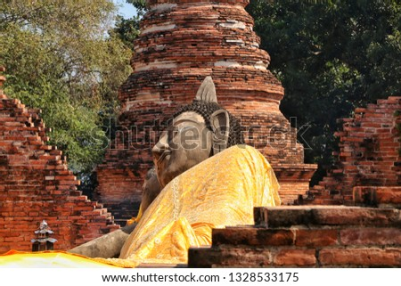 Reclining Buddha statue in Phutthaisawan Temple. Archaeological site at Ayutthaya, Thailand.
