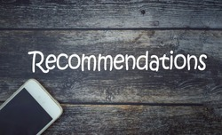 Recommendation wording on a wooden background with vintage style. Selective focus. Business and economy concept