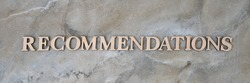 recommendations , writen wooden letters on stone background. recommendations , concep image.