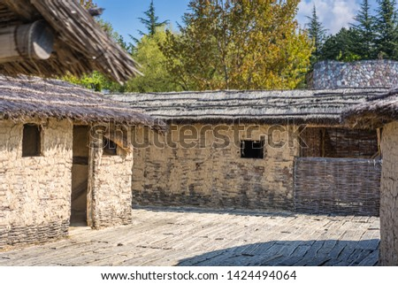 Reconstructed  old traditional huts in the Bay of the bones, Museum on water, authentic reconstruction of the pile dwelling settlement, Ohrid, Republic of Macedonia