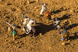 Reconstruction of battle between Crusaders and Saracens with toy figurines. The Crusades were a series of religious wars initiated, supported, and directed by the Latin Church in the medieval period.