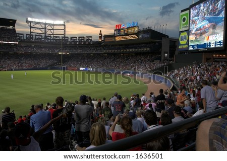 record crowd at Turner Field watches Nascar Cars go by in the outfield