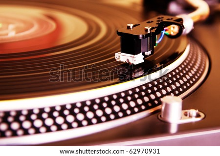Record player spinning the disc with music