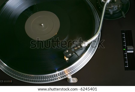 Record Playing on a Hi-Fi Turntable - stock photo