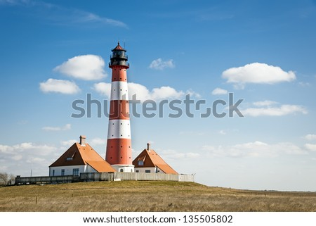 Recording in landscape from the lighthouse westerhever on a sunny day with blue sky and white clouds