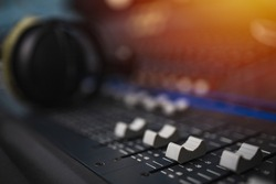 Recording room,Compression room, Music on sound mixer in recording studio.Close Up Shot of Audio Producer Working in Music Recording Studio, Uses Mixing Board Create Modern Song. Sound recording room.