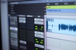 Recording studio audio computer editing mixing program sound controls for music and voice production.