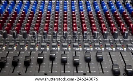 Recording studio audio mixing desk knobs and sliders