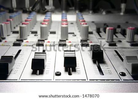 recording studio/mixer illuminated by a studio-spot