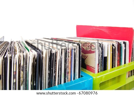 Records in plastic boxes on white, closeup