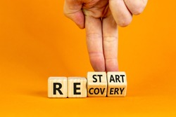 Recovery and restart symbol. Businessman hand turns cubes and changes the word 'recovery' to 'restart'. Beautiful orange background. Business and recovery - restart concept. Copy space.