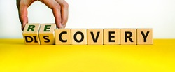 Recovery or discovery symbol. Businessman turns wooden cubes, changes a word 'discovery' to 'recovery'. Beautiful white background. Business and discovery or recovery concept. Copy space.