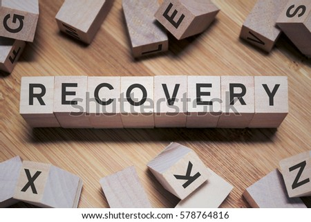Recovery Word Written In Wooden Cube