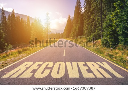 Recovery word written on road in the mountains Foto stock ©