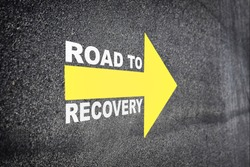Recovery written with yellow arrow on road. Economic recovery  concept and business challenge idea