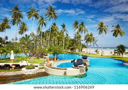 Recreation area with swimming pool on the tropical beach