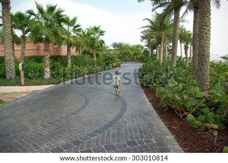 Recreation Park on the shores of the Persian Gulf in Dubai. Lawns, paths, artificial lakes and rivers, trees and shrubs - all created by man on the bare sand.
