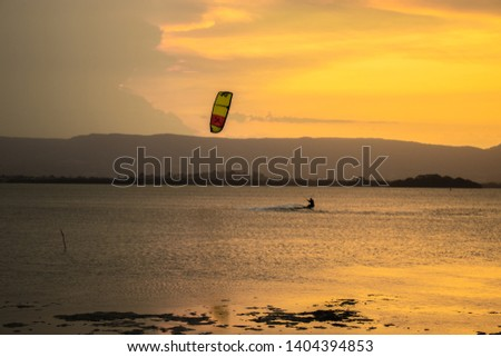 Recreation sport during sunset on lake #1404394853