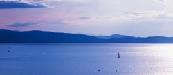 Recreational boating on Lake Champlain in Burlington, Vermont, USA at dusk.