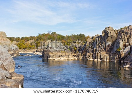 Recreational sport activities at a scenic river turns in Great Falls park, Virginia, USA. Mountainous riverbanks and rapids on Potomac River in autumn. #1178940919