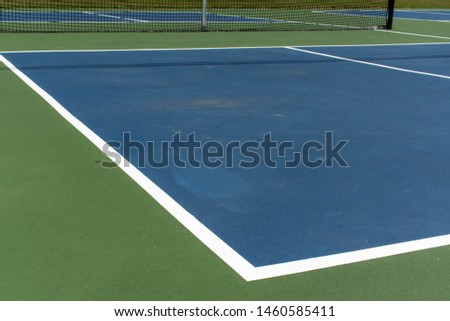 Recreational sport of pickleball court in Michigan, USA looking at an empty blue and green new court at a outdoor park. Ground View. #1460585411