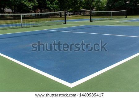 Recreational sport of pickleball court in Michigan, USA looking at an empty blue and green new court at a outdoor park. Ground View. #1460585417