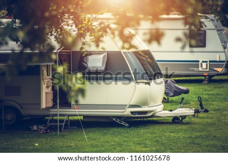 Recreational Vehicle Camping. Vacation in a Travel Trailer. RV Theme. #1161025678