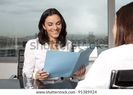 Recruiter checking the CV during job interview