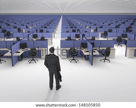 Recruitment.  Businessman in front of endless office cubicles.