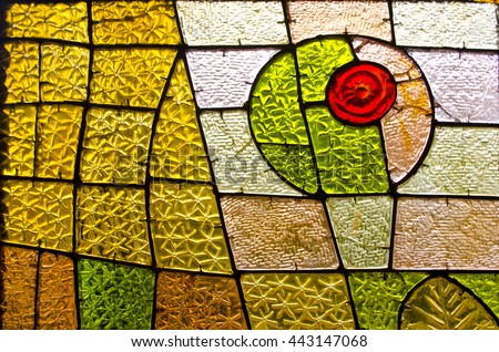 Rectangular and round stained glass window with red rose. Abstract geometric colorful background. Multicolored stained glass church window with irregular random block pattern. #443147068