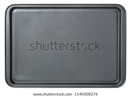Rectangular black baking tray in oven, isolated on white background. Top view baking tray.