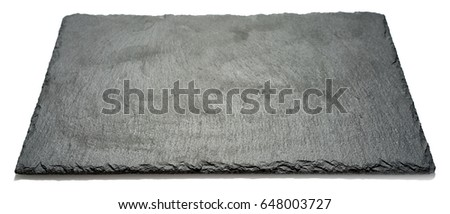 Rectangular black textured slate board for dishes isolated on white background, side angle view with perspective