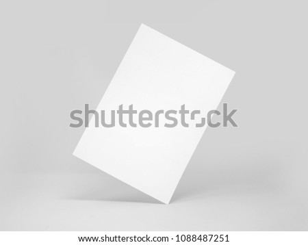 Rectangular blank paper standing on its angle, with shadows, isolated on a white background
