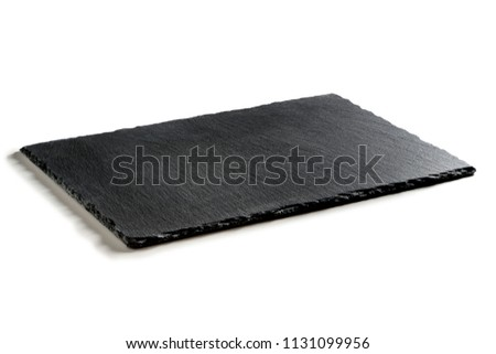 Rectangular empty plate in black slate isolated on white background