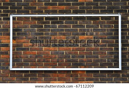 Rectangular metal frame on a brick wall - stock photo