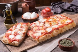 Rectangular shape and thick hand made romana's pizza