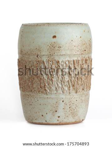 rectangular shaped  vase with scored middle section. mint green and brown colored. white background