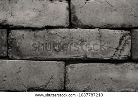 Rectangular stone wall in monochrome