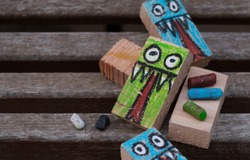 rectangular woods painted with a monster drawing for Halloween