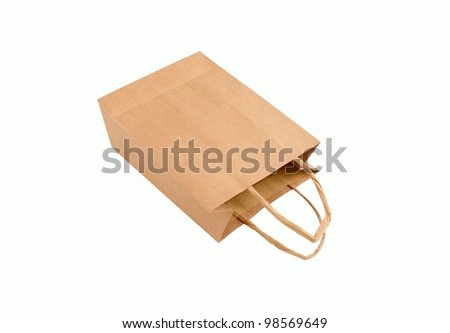 recyclable brown paper bag laying on it's side, isolated on white background