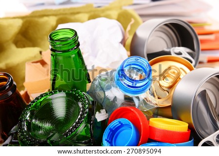 Recyclable garbage consisting of glass, plastic, metal and paper isolated on white background