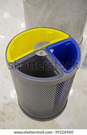 recycle bin in blue yellow and grey