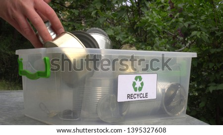 Recycle box for metal cans (aluminum, tin and steel). Sorting and recycling of domestic waste. Household kerbside sorted recyclables #1395327608