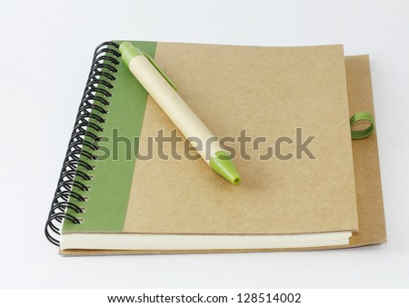 recycle notebook and a pen