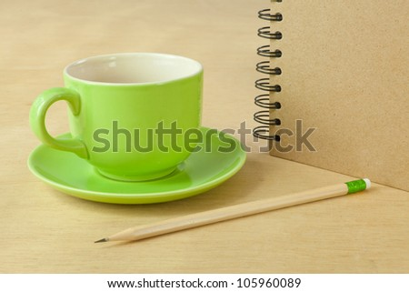 recycle notebook and wooden pencil on wood background
