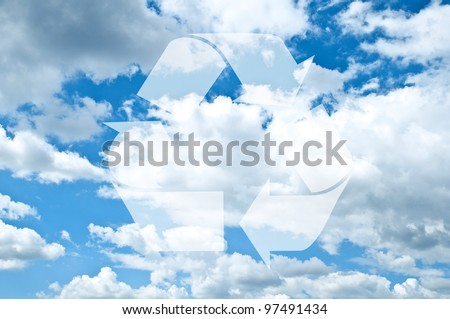 Recycle sign against blue sky with clouds
