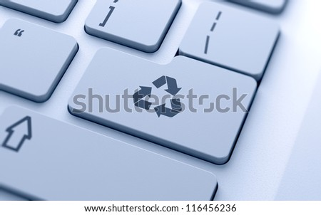 Recycle sign button on keyboard with soft focus - stock photo