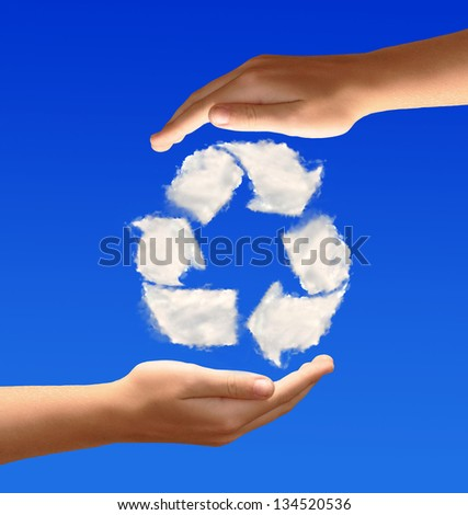 Recycle sign from clouds in the hands - stock photo