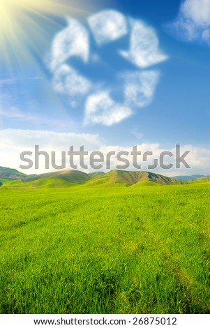 Recycle symbol in the sky with grassland landscape