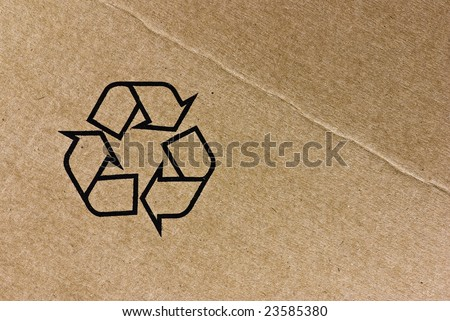 recycle symbol on cardboard texture